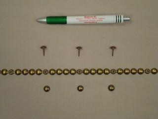 Kárpitos dísz-szeg, méteres, antikolt arany színben (10067)