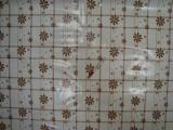 Viaszos vászon, kockás alapon barna-fehér margarétás (10347)