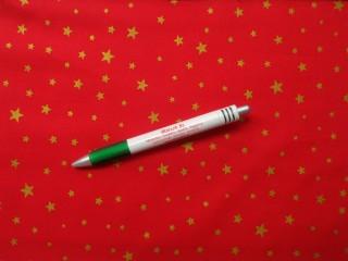 Karácsonyi mintás pamutvászon, piros alapon arany csillagos (10553)