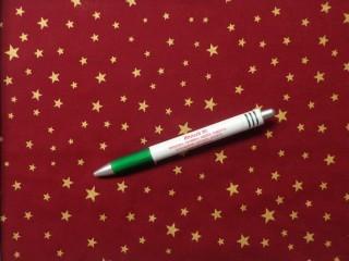 Karácsonyi mintás pamutvászon, bordó alapon arany csillagos (10555)