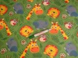 Gyerekmintás pamutvászon, zöld alapon színes állatok (12314)